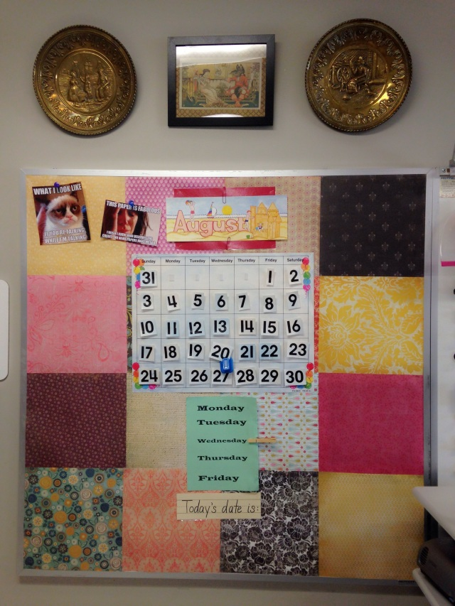 I covered the bulletin boards with some scrapbook paper in warm colors and tapestry designs.